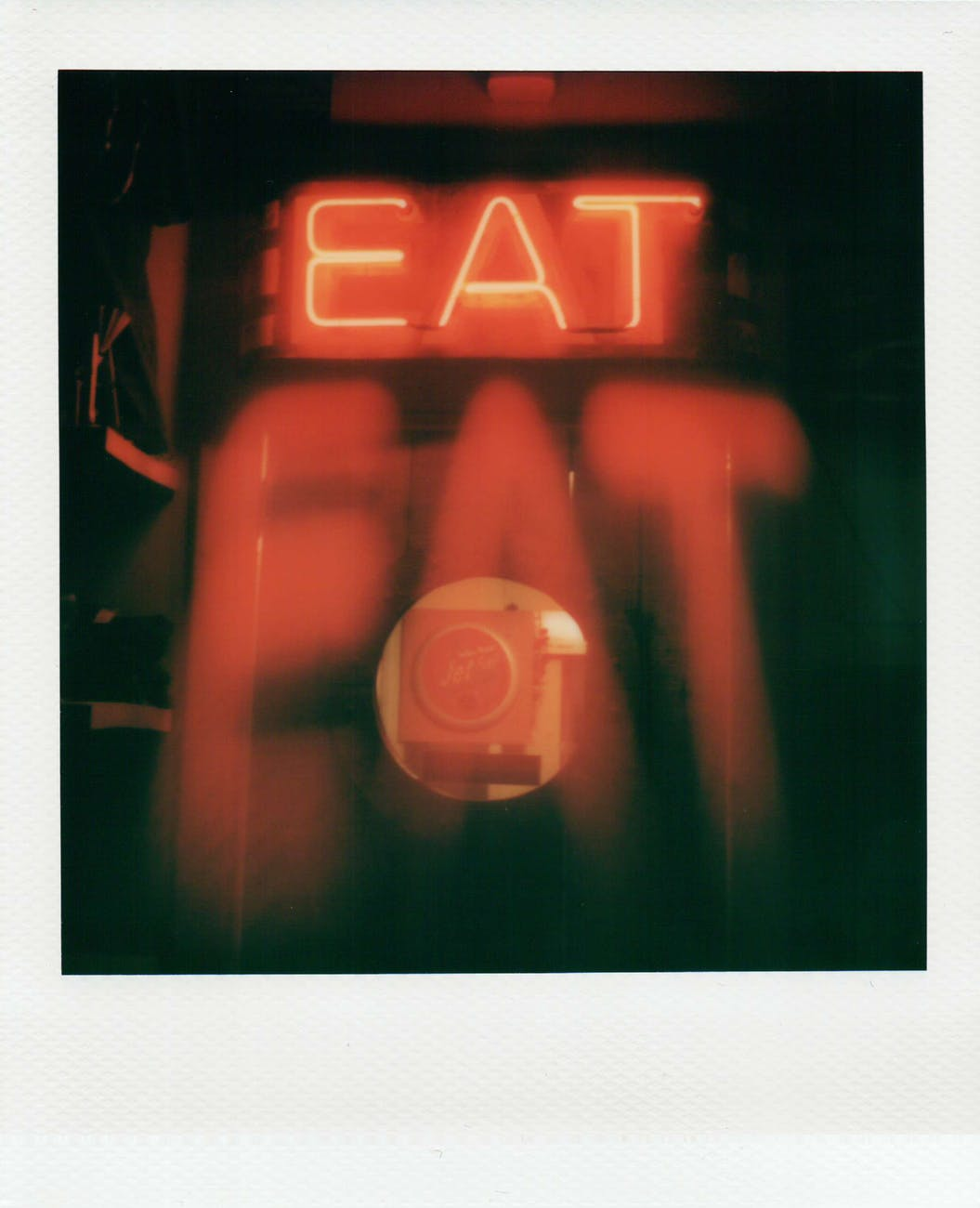 instant photo of a red neon sign